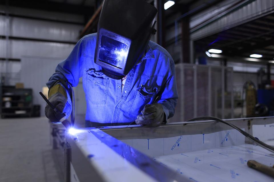 metalworker welding stainless steel